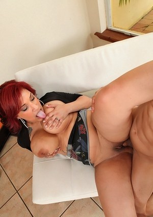 Overweight redhead Jenessa catches a load of cum on her knockers after fucking