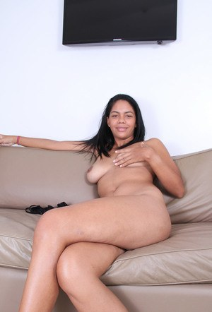 Black amateur Morgan Michele removes bra and panty set to pose nude on couch