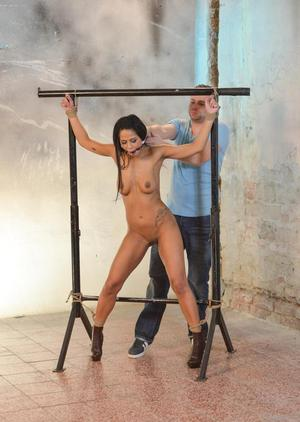 Brunette female Isabella Chrystin is groped after being restrained and gagged