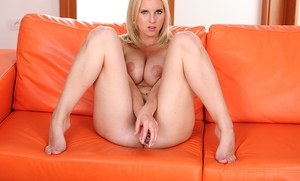 Blonde solo girl with nice tits works a long dildo up her bald pussy