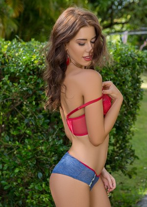 Brunette model Sophie Anne takes off her clothes for Playboy in the back yard