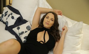 Brunette solo girl Lily Love bares her big natural boobs as she gets undressed
