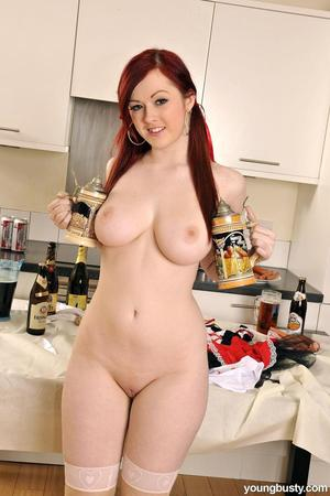 Young redhead shows off her tits and twat while making breakfast