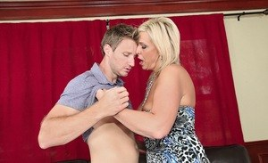 Older blonde MILF Carey Riley sucks a cock with her big tits out of her dress