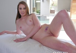 Teen girl Chloe Scott undresses to pose nude on daybed next to outdoor pool