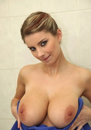 Nude female wets up her pussy and nice melons while taking a shower