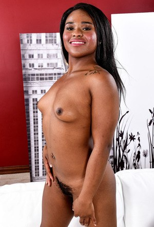 Black girl Charlie Raelets her tiny tits loose before getting fully naked