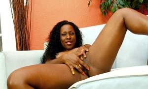 Black pornstar Ms Platinum pleasures her pussy with a sex toy and her fingers
