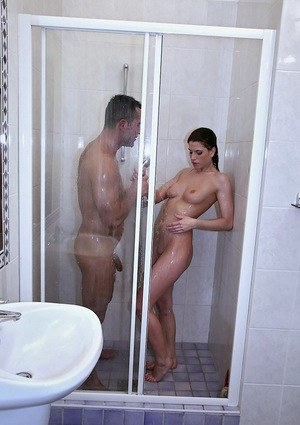 Nude female Kristine Crystalis gives her man friend a blowjob in the shower