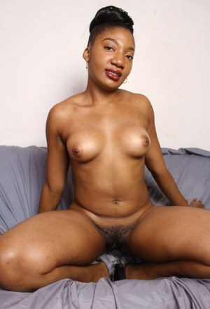 Black solo girl spreads her legs and the her labia lips