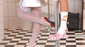 Female nurse finds a schoolgirl to have the same foot fetish inclinations