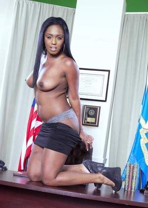 Black solo model Layton Benton strips naked on top of a judge's desk