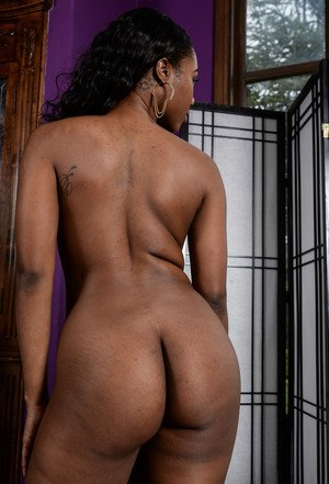 Ebony solo girl Chanell Heart takes off her tube top and skirt to pose naked