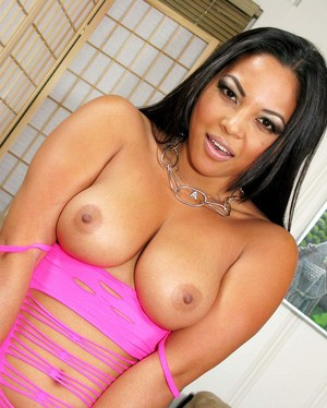 Latina MILF Adrianna Luna bare her big natural tits as she strips naked