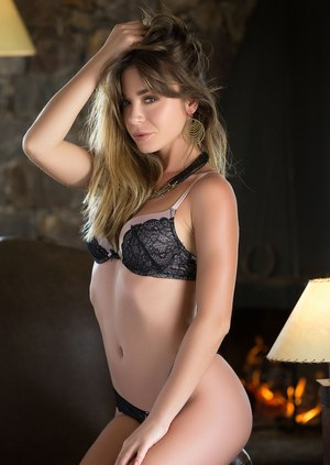 Solo model Lilii peels off her sexy lingerie number to pose nude for Playboy