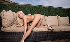 Sexy blonde girl with great legs poses in the nude for Playboy