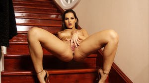 Sex solo model Eve Angel fingers her horny vagina on the wooden staircase