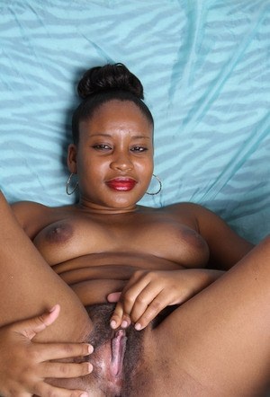 Tall black chick gets naked prior to showcasing her pink pussy