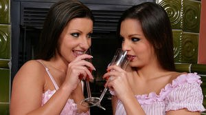 Hot lesbians Eve Angel and Nikki Rider eat pussy after sharing some wine