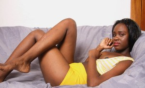 African solo girl shows off her pink snatch for the very first time