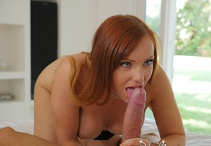 Redhead MILF Dani Jensen licks a long cock until it blows a load