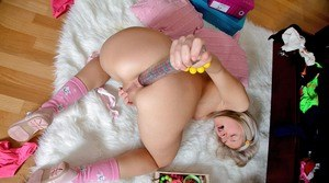 Cute young girl sticks a huge toy in her asshole on her home webcam