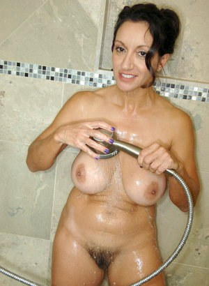 Older woman Persia Monir rides her suction vibrator to glory in the bathroom