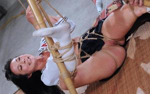 Asian sex slave is tied up with ropes and masturbated until she loses her mind