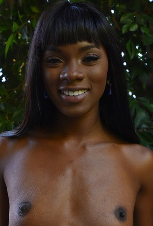 Black female Ana Foxxx takes a piss on the sidewalk in her sneakers only