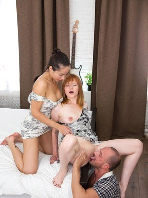 Young bisexed girls give their man friend a blowjob together