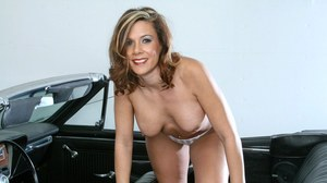 Classy older woman climbs out of a car and proceeds to strip off her clothes
