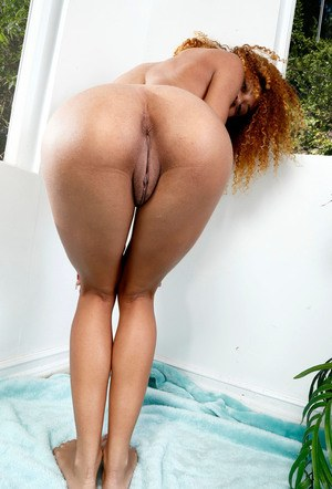 Black amateur with red hair exposes her recently trimmed bush