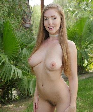 Busty solo girl Lena Paul removes her onesie in the backyard of tropical house