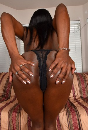 Hot black female Ana Foxxx struts her nude body after taking off her clothes