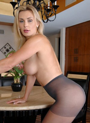 Older blonde lady finishes getting naked by removing her pantyhose