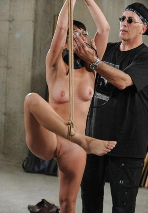 Asian female is made to stand on one foot while being tortured and masturbated