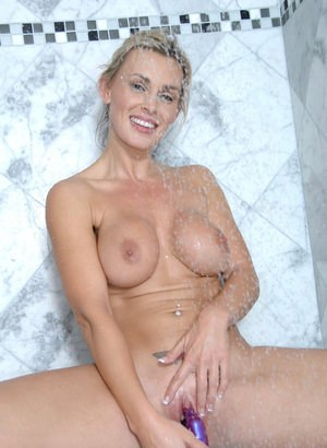 Busty mature woman toys her pussy to glory after getting out of the shower