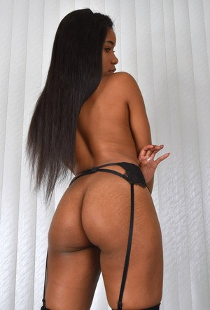 Ebony chick Jenna J Foxx releases her big tits and phat ass from lingerie