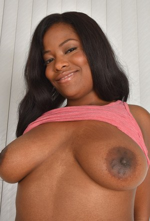 Amateur model Monique Symone hikes up her miniskirt to expose her bald pussy