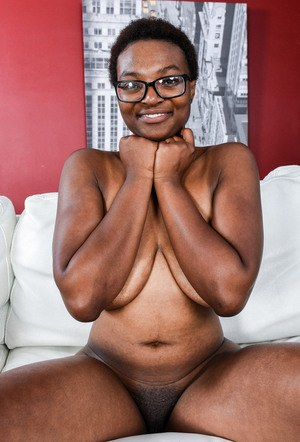 Nerdy black chick Nadyia Foxxx bares her huge boobs and pink vagina