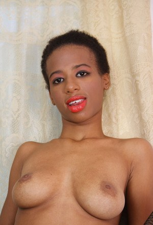 Black female with short hair removes skirt and hose to showcase her pussy
