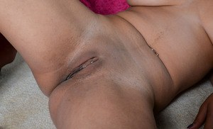 Sexy amateur model shows off the pink of her shaved black pussy