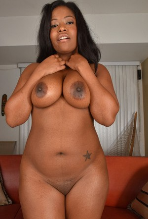 Chubby ebony first timer Monique Symone parts her labia lips wide open