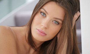 Teen girl Lana Rhoades slides off her shorts and onesie to model in the nude