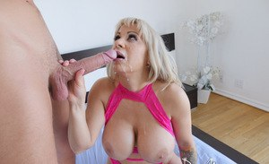 Blonde chick with huge boobs pleasures a big dick with oral sex and a titjob