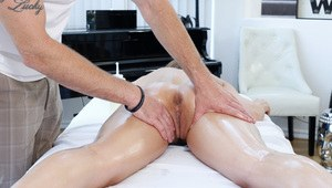 Nude female Dillion Harper gets covered in oil before fucking her masseur