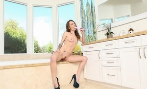 Solo girl Natasha Starr strips to suede high heels prior to masturbating