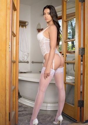 Dark haired female Kelsi Shay removes lingerie and hose before a sponge bath