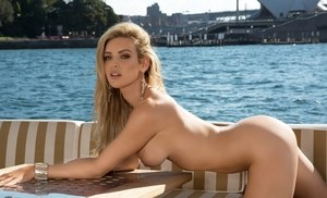 Solo model Jessica Nelson removes her bikini on a boat in Sydney Harbour
