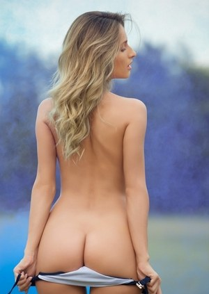 Solo girl Cara Mell strips off her sexy lingerie on the lawn for Playboy